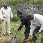 MSSF Chairman Randolf Riley looks on as Deputy Director Venita Cabey and Contractor Emmanuel Galloway turns the soil